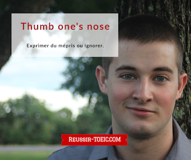 Thumb one's nose